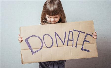 Collecting donations of canned food, clothes..
